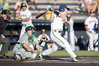 Michigan Wolverines second baseman Jimmy Kerr (15) follows through on his swing during the NCAA baseball game against the Eastern Michigan Eagles on May 16, 2017 at Ray Fisher Stadium in Ann Arbor, Michigan. Michigan defeated Eastern Michigan 12-4. (Andrew Woolley/Four Seam Images)