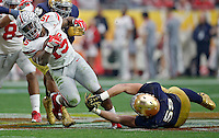 Ohio State Buckeyes running back Ezekiel Elliott (15) gets past Notre Dame Fighting Irish linebacker Jarrett Grace (59) in the third quarter during the Fiesta Bowl in the University of Phoenix Stadium on January 1, 2016.  (Dispatch photo by Kyle Robertson)