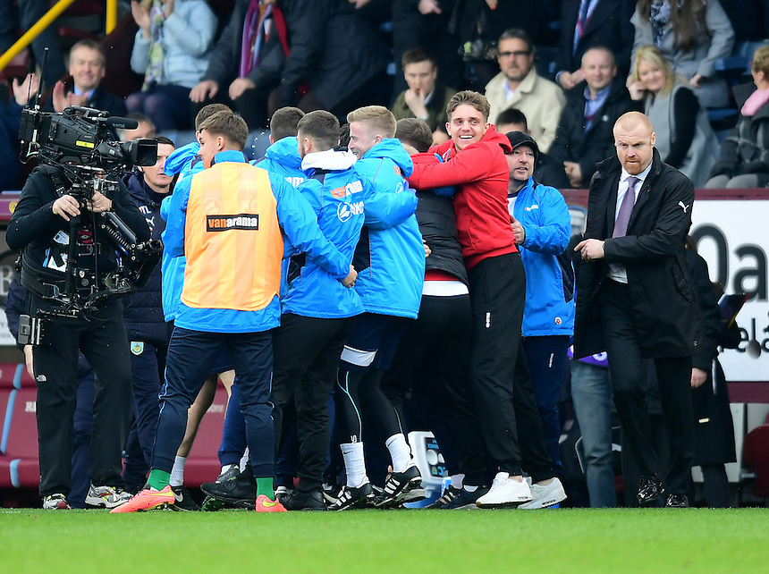 Burnley manager Sean Dyche, right, walks past the Lincoln City players and coaching staff celebrating at the end of the game<br /> <br /> Photographer Chris Vaughan/CameraSport<br /> <br /> Emirates FA Cup Fifth Round - Burnley v Lincoln City - Saturday 18th February 2017 - Turf Moor - Burnley <br />  <br /> World Copyright &copy; 2017 CameraSport. All rights reserved. 43 Linden Ave. Countesthorpe. Leicester. England. LE8 5PG - Tel: +44 (0) 116 277 4147 - admin@camerasport.com - www.camerasport.com
