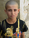 Iraq 2011 <br /> A young Yezidi boy in Lalesh shrine  <br /> Irak 2011 <br /> Un jeune yezidi au sanctuaire de Lalesh