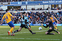 Luke O'Nien of Wycombe Wanderers (2nd left) shoots during the Sky Bet League 2 match between Wycombe Wanderers and Mansfield Town at Adams Park, High Wycombe, England on 25 March 2016. Photo by David Horn.