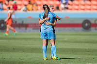 Houston, TX - Saturday May 13, Sky Blue FC defender Erica Skroski (8) and Sky Blue FC midfielder Madison Tiernan (73) hug after securing the victory in a regular season National Women's Soccer League (NWSL) match between the Houston Dash and Sky Blue FC at BBVA Compass Stadium. Sky Blue won the game 3-1.