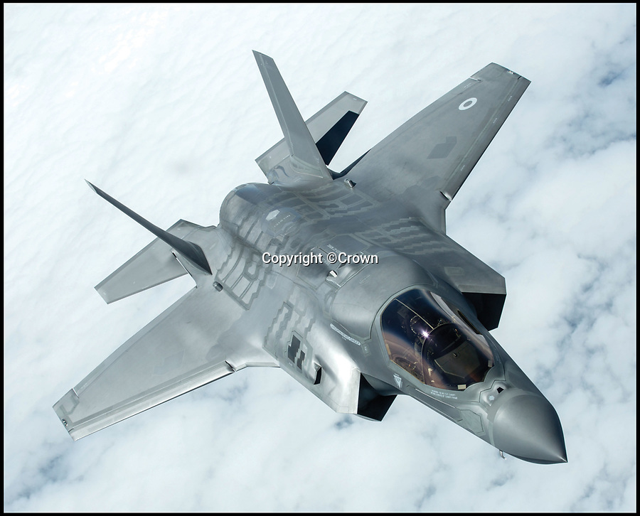 BNPS.co.uk (01202)558833Pic: Crown/BNPS<br /> <br /> The Lockhead Martin F-35B Lightning II fifth generation multi-role fighter.<br /> <br /> These breathtaking photos capture in all its glory the storied history of the mighty Royal Air Force which has defended our shores for 100 years.<br /> <br /> Former fighter pilot Michael Napier celebrates the accomplishments of the world's first independent air force in his new book The Royal Air Force, A Centenary of Operations.<br /> <br /> He reflects on the momentous Battle of Britain where 'the Few' stood up to the dreaded Luftwaffe and also lesser-known humanitarian operations in far-flung parts of the world where the RAF 'dropped food, not bombs'.