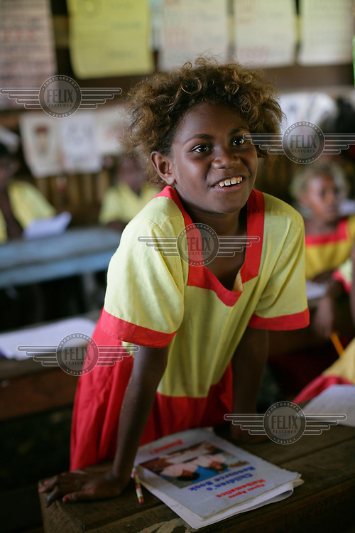 8 year old Betty answers questions in class at Lunga Primary School, 10km east of Honiara..
