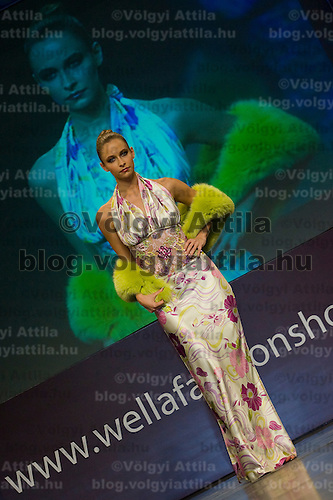 Modell presents a creation during the Wella International Fashion Show held at Vajdahunyad castle.