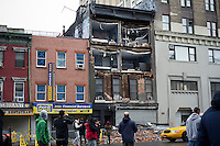 The facade of a building in Chelsea is torn off during Hurricane Sandy seen on Tuesday, October 30, 2012. Hurricane Sandy roared into New York disrupting the transit system and causing widespread power outages. Con Edison is estimating it will take four days to get electricity back to Lower Manhattan. (© Frances M. Roberts)