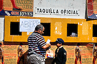 A Spanish man buys bullfight tickets for his young son in Fuengirola, Spain, 28 April 2007.