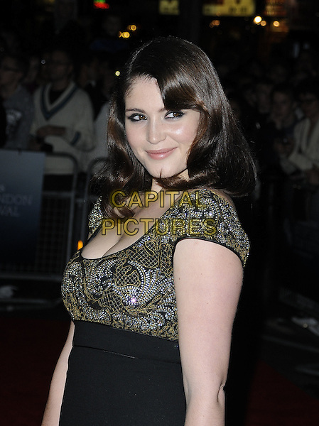 "GEMMA ARTERTON .At the ""The Disappearance of Alice Creed"" Gala Screening during the Times BFI 53rd London Film Festival, Vue West End Leicester Square, London, England, UK, October 24th 2009..half length black high waisted pencil skirt dress gold silver patterned cleavage .CAP/CAN.©Can Nguyen/Capital Pictures"