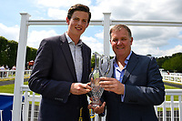 Connections of Pow Wow receive their trophy after winning The Derek Burridge Golf & Racing Trophies Handicap, during Father's Day Racing at Salisbury Racecourse on 18th June 2017
