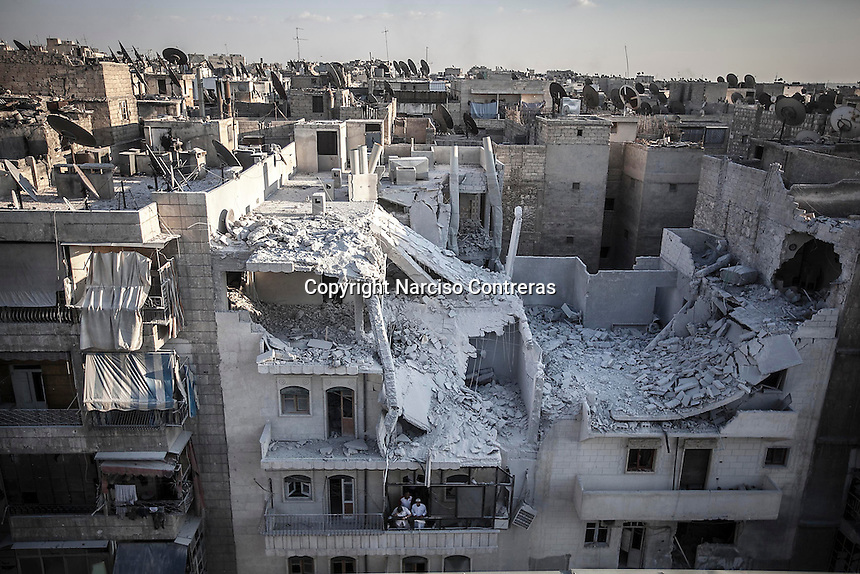 A smashed building is showed up from a top buiding in Tarik Al-bab neighborhood after it was hit by a bomb thrown down from one army airplane.