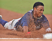 Mississippi Braves second baseman Ozzie Albies (20) slides into third base during a game against the Tennessee Smokies at Smokies Stadium on July 23, 2016 in Kodak, Tennessee. The Braves defeated the Smokies 3-0. (Tony Farlow/Four Seam Images)
