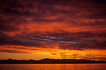 Dramatic sunset over Puget Sound and Olympic Mountain Range stratocumulus clouds Seattle Washington State USA.