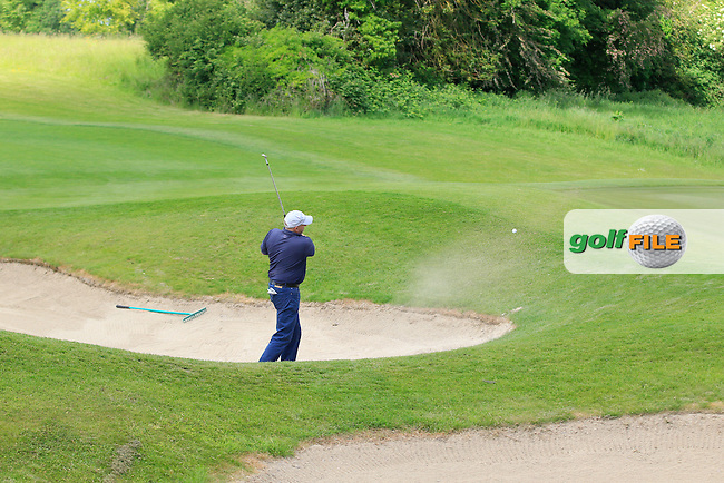 Tony Cleary (Woodstock) plays out of a bunker on the 1st during Round 1 of the Irish Mid-Amateur Open Championship at New Forest on Saturday 20th June 2015.<br /> Picture:  Thos Caffrey / www.golffile.ie