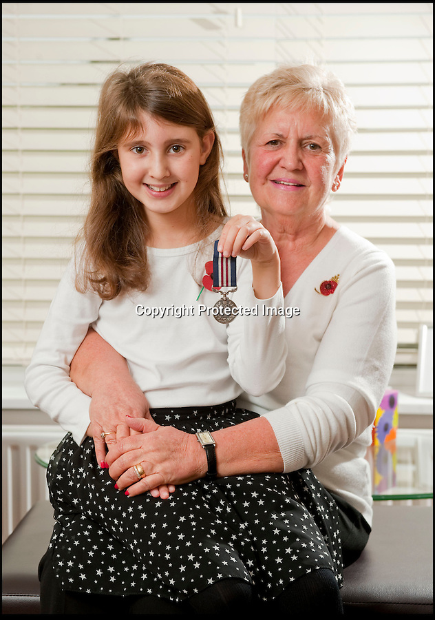 BNPS.co.uk (01202 558833)<br /> Pic: PhilYeomans/BNPS<br /> <br /> Proud family - Elizabeth Turner with her grandfathers MM and Sheila(grandmum) who bought his medal back from the internet.<br /> <br /> A nine-year-old girl's school project has led her family to find her war hero great-grandfather's gallantry medal they knew nothing about.<br /> <br /> Elizabeth Turner asked her grandmother Sheila Scott for help with her homework on World War Two and was told about a late relative who fought in Europe.<br /> <br /> James Angel was a modest man who rarely spoke about his experiences of war, including<br /> winning the Military Medal for one incredibly heroic action.<br /> <br /> Sapper Angel put himself in the line of fire when Allied soldiers were pinned down by Germans as they tried to cross the Rhine in Germany in March 1945.<br /> <br /> With great risk to his own life, he drew enemy fire away from his comrades by engaging them with his Bren gun and allowed the British to locate and silence the Germans.<br /> <br /> It is believed that after the war Mr Angel sold his Military Medal to help provide for his seven children.<br /> <br /> His family knew he once had a 'special medal' but had no idea what it was or was for until Elizabeth began her school project two weeks ago.<br /> --