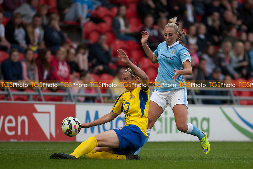 Leandra Little (Belles) and Toni Duggan (Man City Women)<br /> Doncaster Rovers Belles vs Manchester City Women, FA Womens Super League Continental Tyres Cup Football at the Keepmoat Stadium, Stadium Way, Doncaster, West Riding of Yorkshire on 23/07/2015 - MANDATORY CREDIT: Mark Hodsman/TGSPHOTO