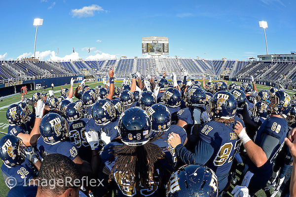 19 September 2015:  FIU's team gathers on the field prior to the game as the FIU Golden Panthers defeated the North Carolina Central University Eagles, 39-14, at FIU Stadium in Miami, Florida.