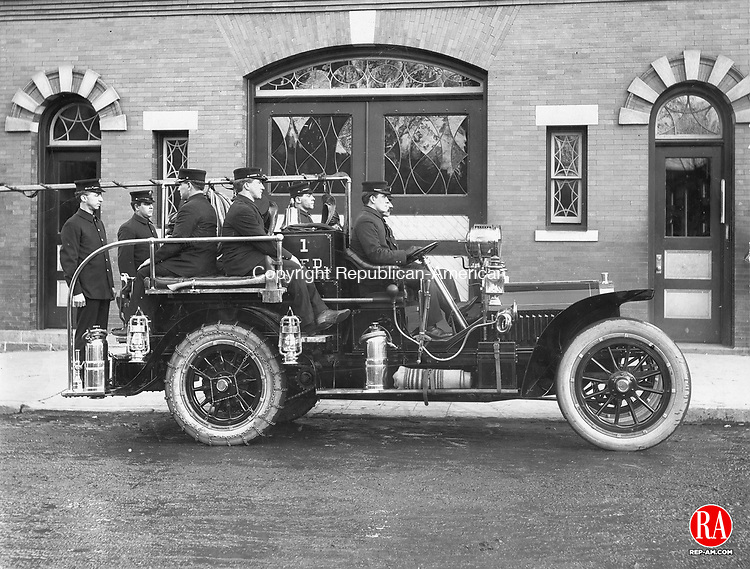 Waterbury Fire Department's first auto hose wagon. Pictured in this, November 1908, photograph is, in rear William O'Donnel and William Russell; the driver is Edward Madden, to his left is Captain Hery H. Heitman, behind the driver is Patrick Croce, and the other person is unidentified.