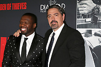"LOS ANGELES - JAN 17:  Curtis Jackson, 50 Cent, Christian Gudegast at the ""Den of Thieves"" Premiere at Regal LA Live Theaters on January 17, 2018 in Los Angeles, CA"