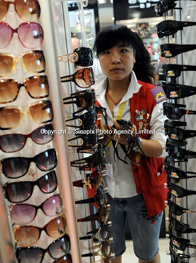 "Fake Doce and Gabanna sunglasses sale at the silk Market. The ""Silk Market"" in Central Beijing is proving a major tourist attraction with thousands of Olympic tourists flocking there daily in order to purchase fake designer goods ranging from clothing to watches.  The Beijing authorities closed hundreds of night-clubs and introduced many restriction on and rules ahead of the 2008 Olympics in the city mysteriously has allowed the trade of fake goods to foreigners continue, thumbing their nose at western companies.<br />
