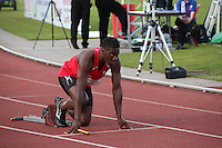 Tuesday 15th July 2014<br /> Pictured: Christian Malcolm <br /> RE: Welsh Sprinter Christian Malcolm positioned in the starting blocks, head up and looking foreword while holding a relay baton, about to compete in the Welsh Athletics International 4x100m relay at the Cardiff International Sports Stadium, Wales, UK. His last race on home soil.
