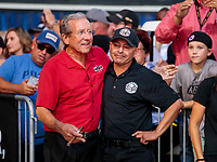 Nov 17, 2019; Pomona, CA, USA; Don Schumacher (left) hugs NHRA top fuel driver Mike Salinas during the Auto Club Finals at Auto Club Raceway at Pomona. Mandatory Credit: Mark J. Rebilas-USA TODAY Sports