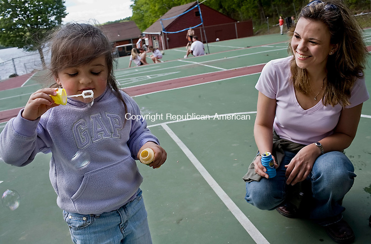 MIDDLEBURY--24 May 08--052408TJ01 - Ella McCasland, 3, from Middlebury, blows bubbles as her mother, Kirsten, watches at the Middlebury Recreation Area on Saturday, May 24, 2008, the rec area's opening day. (T.J. Kirkpatrick/Republican-American)