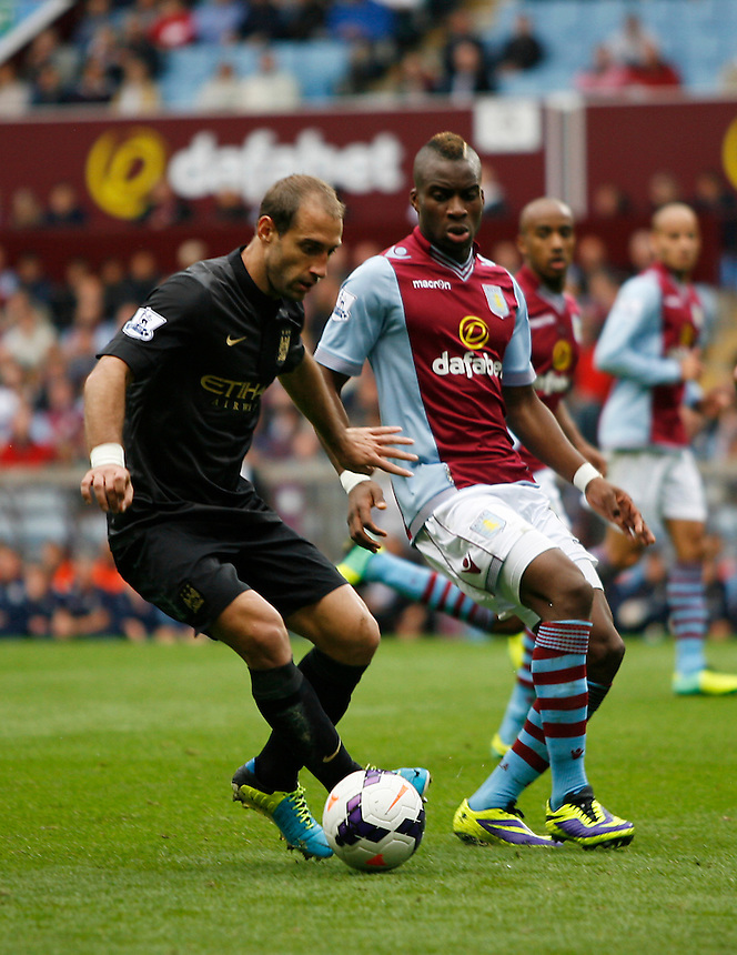 Manchester City's Pablo Zabaleta (L) and Aston Villa's Yacouba Sylla in action during todays match  <br /> <br /> Photo by Jack Phillips/CameraSport<br /> <br /> Football - Barclays Premiership - Aston Villa v Manchester City - Saturday 28th September 2013 - Villa Park - Birmingham<br /> <br /> &copy; CameraSport - 43 Linden Ave. Countesthorpe. Leicester. England. LE8 5PG - Tel: +44 (0) 116 277 4147 - admin@camerasport.com - www.camerasport.com