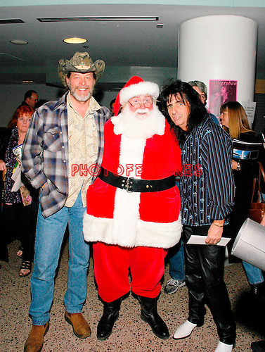 Ted Nugent, Santa Claus and Alice Cooper at Alice Cooper's Christmas Pudding show for his Solid Rock Foundation Charity at Dodge Theatre in Phoenix, Arizona, December 18th 2004. Photo by Chris Walter/Photofeatures.