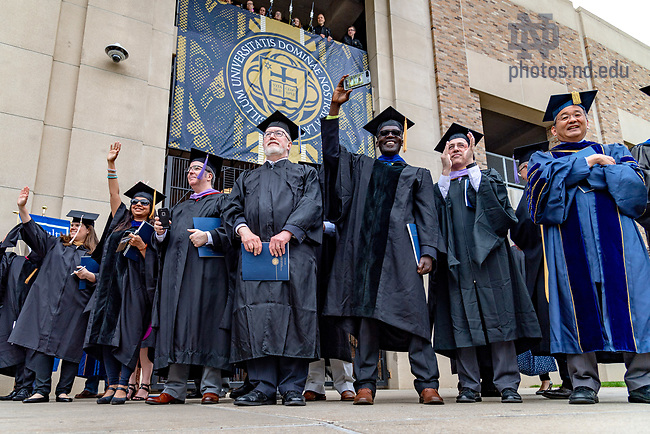 May 20, 2018; Faculty wave to graduates as they enter Notre Dame Stadium for Commencement 2018. (Photo by Matt Cashore/University of Notre Dame)