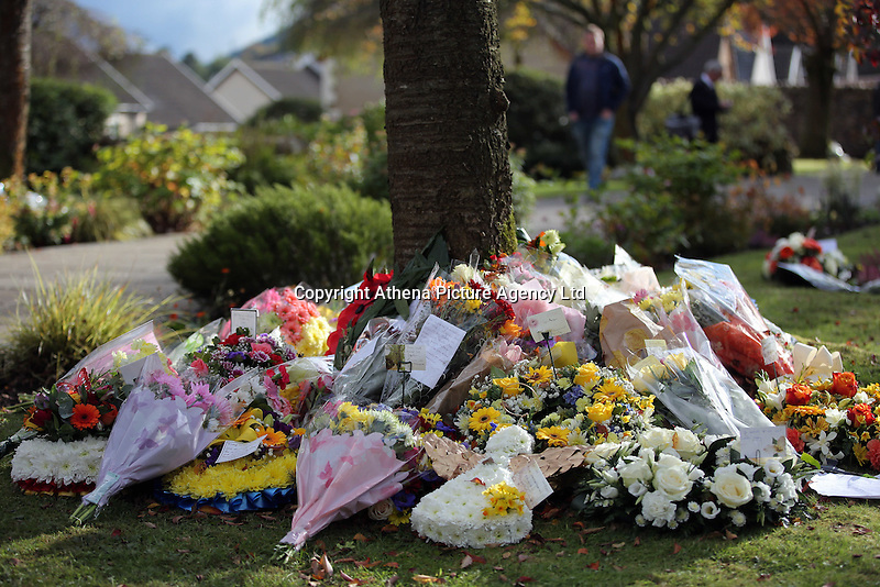 Pictured: Flowers left at the Memorial Garden Friday 21 October 2016<br />