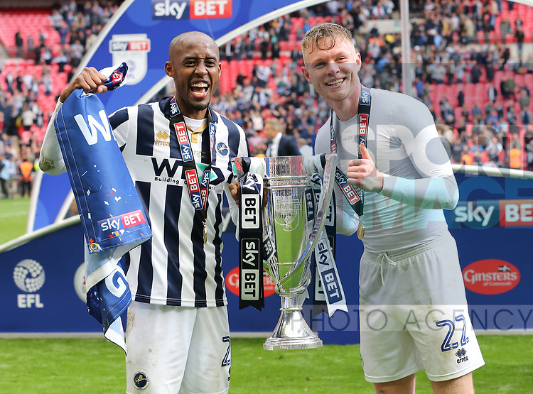 Millwall's Nadjim Abdou and Aiden O'Brien celebrate with the trophy during the League One Play-Off Final match at Wembley Stadium, London. Picture date: May 20th, 2017. Pic credit should read: David Klein/Sportimage