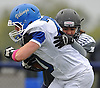Port Washington No. 70 Jake Bazzini fights for yards after recovering a fumble by his team during a Nassau County Conference I varsity football game against host Plainview JFK High School on Saturday, October 3, 2015. Plainview JFK won by a score of 42-0.<br /> <br /> James Escher