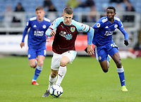 Burnley's Johann Gudmundsson drives forward chased by Leicester City's Wilfred Ndidi<br /> <br /> Photographer Rich Linley/CameraSport<br /> <br /> The Premier League - Burnley v Leicester City - Saturday 16th March 2019 - Turf Moor - Burnley<br /> <br /> World Copyright © 2019 CameraSport. All rights reserved. 43 Linden Ave. Countesthorpe. Leicester. England. LE8 5PG - Tel: +44 (0) 116 277 4147 - admin@camerasport.com - www.camerasport.com