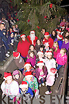 Lights On: A special guest arrived in Ballybunion last Friday night to help turn on the Christmas lights outside of the local Garda station.