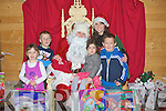 PRESENTS: Meeting Santa getting presents from Santa at the Grotto at The Ballyseedy Garden Outdoor & Living Centre, Tralee on Saturday, l-r: David and Rebecca O'Sullivan, Padraig O'Sullivan, Maggie and Lily Hillard and Naomi Reidy (Elf)..................... ..........