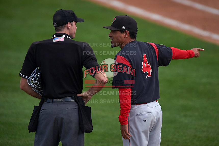 Batavia Muckdogs manager Angel Espada (4) argues a call with umpire Brandin Sheeler during a game against the Auburn Doubledays on September 7, 2015 at Falcon Park in Auburn, New York.  Auburn defeated Batavia 11-10 in ten innings.  (Mike Janes/Four Seam Images)
