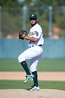 Oakland Athletics pitcher Oscar Tovar (54) delivers a pitch to the plate during an Instructional League game against the Cincinnati Reds on September 29, 2017 at Lew Wolff Training Complex in Mesa, Arizona. (Zachary Lucy/Four Seam Images)