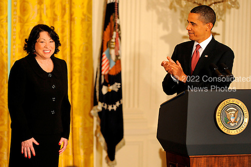 Washington, DC - August 12, 2009 -- United States President Barack Obama (R) applauds Supreme Court Justice Sonia Sotomayor as they arrive for a reception to honor her recent swearing in, in the East Room of the White House in Washington, DC, USA August 12, 2009.   .Credit: Mike Theiler - CNP