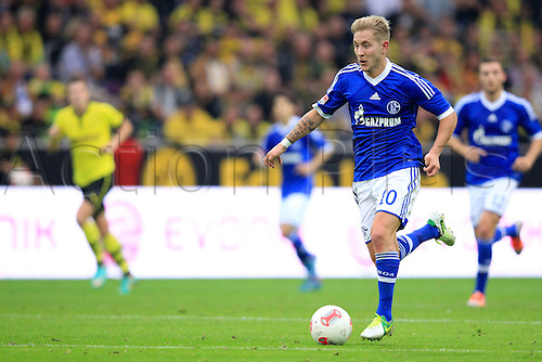 220.10.2012. Dortmund, Germany   Bundesliga  Borussia Dortmund versus FC Schalke 04. Lewis Holtby Schalke 04 10 drives forward to score the goal