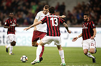 Calcio, Serie A: Milano, stadio Giuseppe Meazza (San Siro), 1 ottobre 2017.<br /> Roma's Edin Dzeko (l) scores during the Italian Serie A football match between Milan and AS Roma at Milan's Giuseppe Meazza (San Siro) stadium, October 1, 2017,<br /> UPDATE IMAGES PRESS/Isabella Bonotto