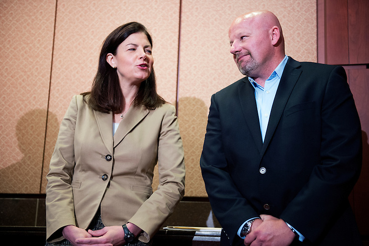 UNITED STATES - MAY 14: Sen. Kelly Ayotte, R-N.H., talks with Eric Brandenburg, who received a Silver Star while serving in the U.S. Air Force, during a news conference in the Capitol Visitor Center to oppose the deactivation of the A-10 fighter aircraft, May 14, 2014. (Photo By Tom Williams/CQ Roll Call)