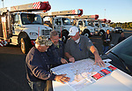 JCP&L Employees (L to R) Tom Bodine, Joe Ribas & Ed France look over a map of the Eastern United States as they prepare to lead JCP&L Crews south from First Energy Park in Lakewood, New Jersey in support of Hurricane Irma restoration efforts.