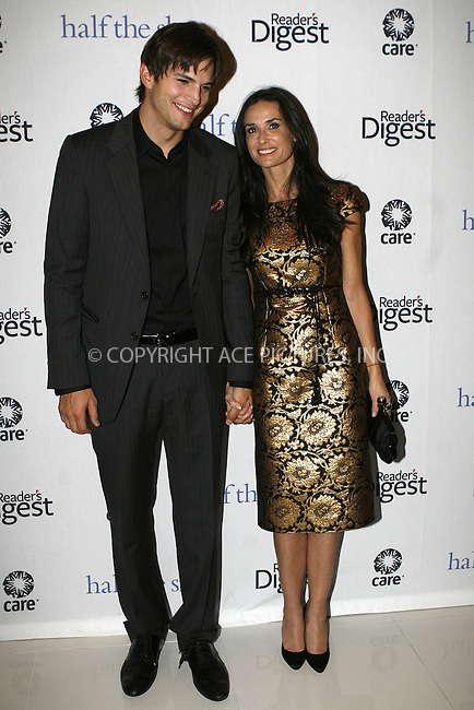 WWW.ACEPIXS.COM . . . . .  ....September 23 2009, New York City....Ashton Kutcher and Demi Moore attend the ''Half The Sky'' book party by Reader's Digest and C.A.R.E. at Moura Starr  on September 23, 2009 in New York City.....Please byline: NANCY RIVERA- ACE PICTURES.... *** ***..Ace Pictures, Inc:  ..tel: (212) 243 8787 or (646) 769 0430..e-mail: info@acepixs.com..web: http://www.acepixs.com