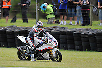 PHILLIP ISLAND, 27 FEBRUARY - James Toseland (GBR) riding the BMW S1000 RR (52) of the BMW Motorrad Italia SBK Team runs off the track during race one of round one of the 2011 FIM Superbike World Championship at Phillip Island, Australia. (Photo Sydney Low / syd-low.com)