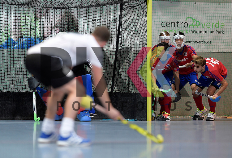 GER - Mannheim, Germany, November 28: During the 1. Bundesliga Sued Herren indoor hockey match between Mannheimer HC (red) and TG Frankenthal (white) on November 28, 2015 at Irma-Roechling-Halle in Mannheim, Germany. Final score 7-7 (HT 3-3). <br /> <br /> Foto &copy; PIX-Sportfotos *** Foto ist honorarpflichtig! *** Auf Anfrage in hoeherer Qualitaet/Aufloesung. Belegexemplar erbeten. Veroeffentlichung ausschliesslich fuer journalistisch-publizistische Zwecke. For editorial use only.