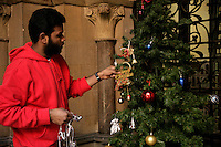 A Sri Lankan refugee dressing the Christmas tree at the Crimean Church, Istanbul, Turkey