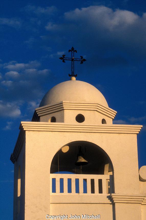Belltower of church in Flores, an island town in Lake Peten Itza, El Peten, Guatemala