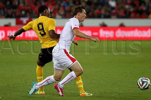 30.05.2014. Lucerne, Switzerland. International football friendly. Switzerland versus Jamaica.  Michael Seaton (JAM) tackles  Stephan Lichtsteiner (SUI)