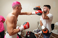 Anton Haskins (L) warms up with father Lee in the dressing room during a Boxing Show at Whitchurch Leisure Centre on 5th October 2019. Lee Haskins and his son Anton Haskins both appeared on the same card, Anton making his professional debut.