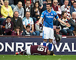 Hearts v St Johnstone...02.08.15   SPFL Tynecastle, Edinburgh<br /> Joe Shaughnessy reacts as Juanman Delgado goes down again<br /> Picture by Graeme Hart.<br /> Copyright Perthshire Picture Agency<br /> Tel: 01738 623350  Mobile: 07990 594431